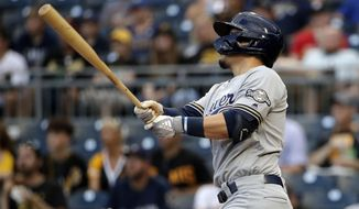 Milwaukee Brewers' Keston Hiura follows through on a two-run home run off Pittsburgh Pirates starting pitcher Trevor Williams during the first inning of a baseball game in Pittsburgh, Wednesday, Aug. 7, 2019. (AP Photo/Gene J. Puskar)