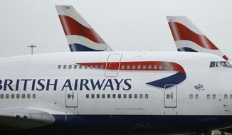 FILE - This Jan. 10, 2017 file photo, British Airways planes are parked at Heathrow Airport in London.  British Airways said Wednesday Aug. 7, 2019, it has canceled some dozens of flights from London airports after its check-in systems were hit by a computer glitch.(AP Photo/Frank Augstein, File)