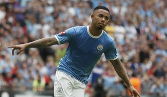 Manchester City's Gabriel Jesus celebrates after scoring in a penalty shoot out, with his goal winning the shot out and the match 5-4, during the Community Shield soccer match between Manchester City and Liverpool at Wembley Stadium in London, Sunday, Aug. 4, 2019. The match ended 1-1 and Manchester City won the match 5-4 after a penalty shoot out. (AP Photo/Frank Augstein)