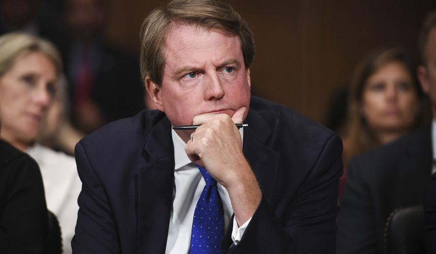 In this Sept. 27, 2018, file photo, then-White House counsel Don McGahn listens as Supreme Court nominee Brett Kavanaugh testifies before the Senate Judiciary Committee on Capitol Hill in Washington. (Saul Loeb/Pool Photo via AP) **FILE**