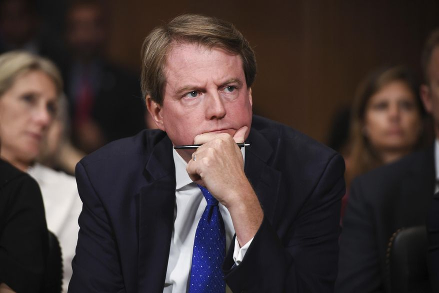 In this Sept. 27, 2018, photo, then-White House counsel Don McGahn listens as Supreme Court nominee Brett Kavanaugh testifies before the Senate Judiciary Committee on Capitol Hill in Washington. (Saul Loeb/Pool Photo via AP) **FILE**