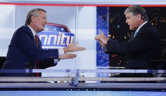 "Fox News host Sean Hannity, right, interviews Democratic presidential candidate and New York Mayor Bill de Blasio during a taping of his show, ""Hannity,"" Wednesday, Aug. 7, 2019, in New York. (AP Photo/Frank Franklin II)"