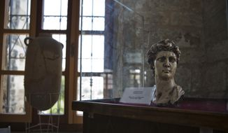 In this July 16, 2019, file photo, an ancient bust of King David is displayed inside the historical Pasha Palace run by Gaza's Ministry of Tourism and Antiquities, in Gaza City. (AP Photo/Khalil Hamra) ** FILE **