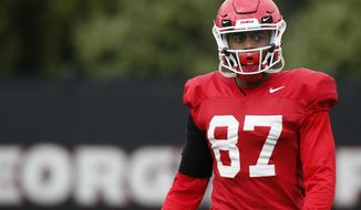 FILE - In this March 26, 2019, file photo, Georgia wide receiver Tyler Simmons (87) participatesn in an NCAA football spring practice in Athens, Ga. Quarterback Jake Fromm is breaking in an almost completely new corps of wide receivers after losing the Bulldogs' top five leaders in catches from 2018. Tyler Simmons is one of Georgia's few returning receivers with significant experience. (Joshua L. Jones/Athens Banner-Herald via AP, File)