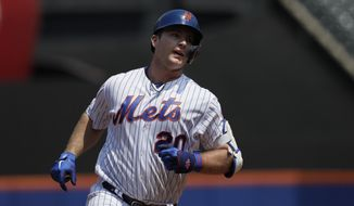 New York Mets' Pete Alonso rounds the bases with a two-run home run against the Miami Marlins in the first inning of a baseball game, Wednesday, Aug. 7, 2019, in New York. (AP Photo/Mark Lennihan)