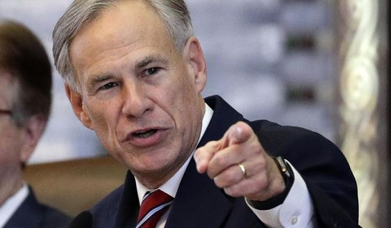 FILE - In this Feb. 5, 2019, file photo, Texas Gov. Greg Abbott gives his State of the State Address in the House Chamber in Austin, Texas. Abbott said Wednesday, Aug. 7, 2019, he will work to keep guns out of the hands of dangers people, though he never mentioned gun control. (AP Photo/Eric Gay, File)
