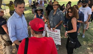 """Democratic presidential candidate Beto O'Rourke, meets with residents of El Paso, Texas, after a community """"unity"""" rally a few blocks from the University Medical Center of El Paso where victims of Saturday's shooting are being treated Wednesday, Aug. 7, 2019. Speaking to several hundred people, O'Rourke said immigrants had made El Paso one of the safest cities in America, before Saturday's shooting. (AP Photo/Morgan Lee)"""