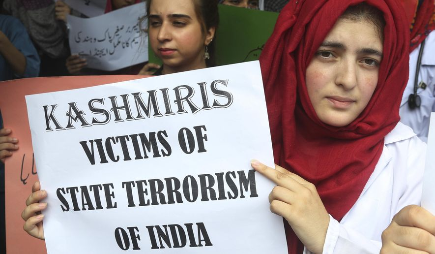 Pakistani students attend an anti-Indian rally in Lahore, Pakistan, Wednesday, Aug. 7, 2019. Pakistan has decided to downgrade its diplomatic ties with neighboring India and suspend bilateral trade in response to New Delhi's decision to reduce the special status of Kashmir, a Himalayan region claimed by both countries. (AP Photo/K.M. Chaudary)