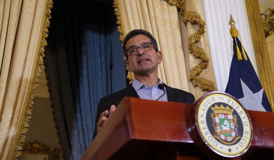 Pedro Pierluisi, sworn in as Puerto Rico's governor last week, speaks during a press conference at the government mansion La Fortaleza in San Juan, Puerto Rico, Tuesday, Aug. 6, 2019. After a sustained protest movement led to the resignation of the previous governor, the island's 3.2 million people now await the final outcome of the constitutional deadlock pitting Puerto Rico's Senate against Pedro Pierluisi. (AP Photo/Dennis M. Rivera Pichardo)