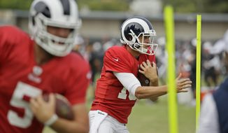 Los Angeles Rams quarterbacks Jared Goff, right, and Blake Bortles (5) run through obstacles during NFL football training camp Wednesday, Aug. 7, 2019, in Napa, Calif. Both the Oakland Raiders and the Los Angeles Rams held a joint practice before their upcoming preseason game on Saturday. (AP Photo/Eric Risberg)
