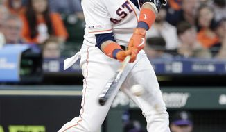 Houston Astros Yuli Gurriel connects for a one run RBI single during the sixth inning of a baseball game against the Colorado Rockies Wednesday, Aug. 7, 2019, in Houston. (AP Photo/Michael Wyke)