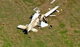 This photo made from video provided by KTTV Fox11 News shows the wreckage of a single-engine plane that crashed at Camarillo, Calif., Airport, killing a few people Wednesday, Aug. 7, 2019. Federal Aviation Administration spokesman Ian Gregor says the homebuilt Express Series 2000 crashed Wednesday under unknown circumstances just short of a runway at the airport. (KTTV Fox11 News via AP)