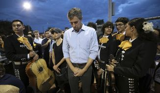 Presidential candidate and El Pasoan Beto O'Rourke prays during the Hope Border Institute prayer vigil Sunday, Aug. 4, 2019 in El Paso, Texas, a day after a mass shooting at a Walmart store. (Mark Lambie/The El Paso Times via AP)