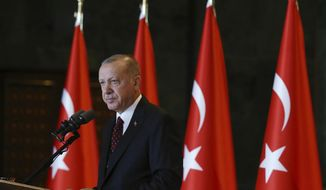 Turkey's President Recep Tayyip Erdogan addresses his country's ambassadors in Ankara, Turkey, Tuesday, Aug. 6, 2019. Turkey's combative president is threatening to launch a military operation in northeastern Syria that is designed to push back U.S.-allied Syrian Kurdish forces, an invasion that carries major risks for a highly combustible region in war-devastated Syria.(Presidential Press Service via AP, Pool)