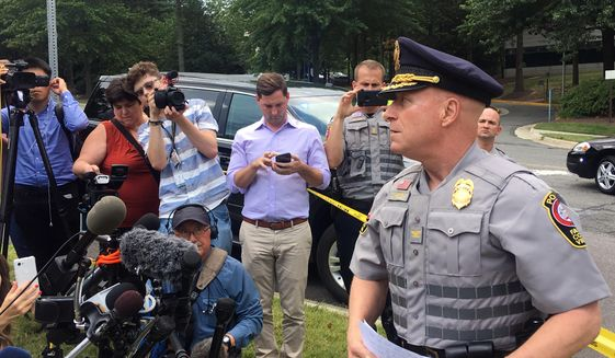 Fairfax County Police Chief Edwin Roessler briefs reporters on reports of a man with a gun entering the McLean office building that is home to USA Today headquarters, Wednesday, Aug. 7, 2019, in McLean, Va. Roessler says it's not clear yet whether that report is true. He says so far there are no reports of gunshots being fired.  (AP Photo/Matthew Barakat) ** FILE **