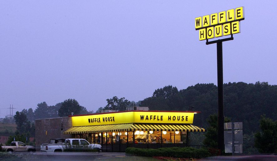 In this July 28, 2005, file photo, traffic flashes by breakfast diners at a Waffle House near Dawsonville, Ga. (AP Photo/Ric Feld, File)