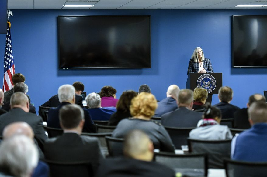 Principal Deputy Director of National Intelligence Susan M. Gordon speaks in Bethesda, Md., Friday, Feb. 16, 2018, to state election officials from all 50 states in the first of two classified briefings being held to raise awareness of foreign meddling in state election systems. The briefings are being hosted by the national intelligence director's office, the FBI and the Department of Homeland Security to discuss ways to mitigate the threat and improve communication between states and the federal government. The state officials were briefed on the threat from foreign intelligence services, cyber threats and foreign influence operations. The classified briefing was held for officials from the National Association of Secretaries of State, the National Association of State Election Directors and the Election Assistance Commission. (Brian Murphy/Office of the Director of National Intelligence via AP)