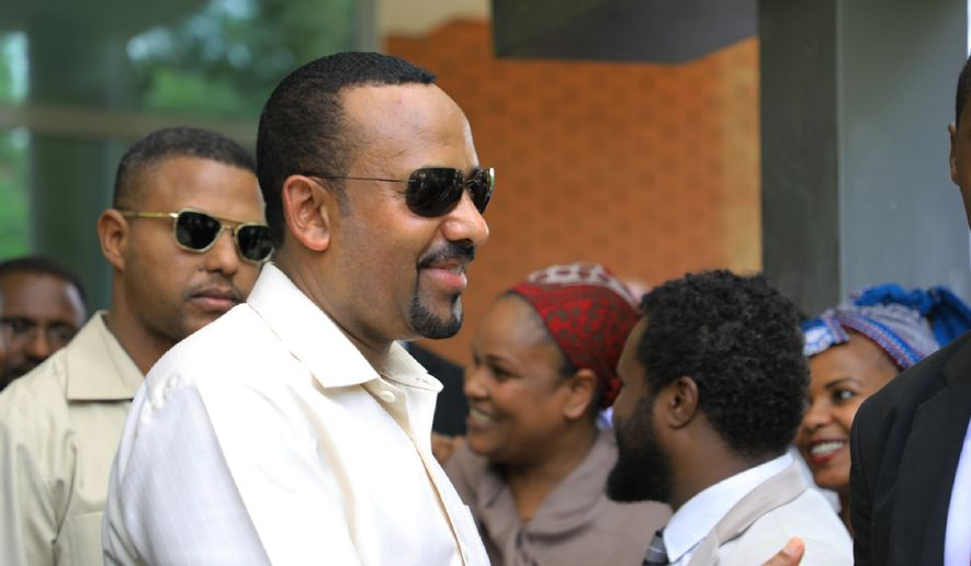 Ethiopia's Prime Minister Abiy Ahmed arrives in Khartoum, Sudan on Friday, June 7, 2019, to try and mediate between the ruling military and the country's protest leaders amid an army crackdown that has killed over 100 people this week. (AP Photo) ** FILE **