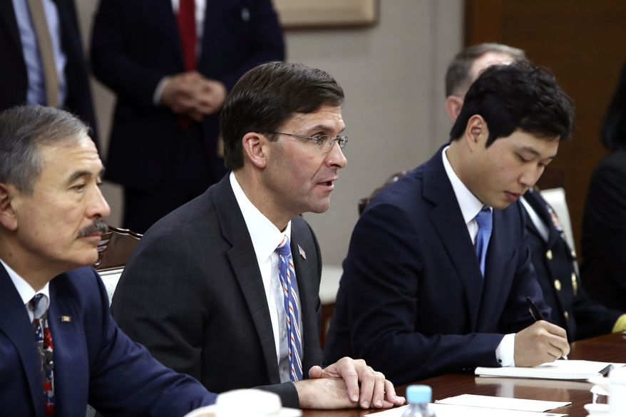 U.S. Defense Secretary Mark Esper, center, holds a talk with South Korean Defense Minister Jeong Kyeong-doo during their meeting Friday, Aug. 9, 2019 in Seoul, South Korea(Pool Photo via AP)