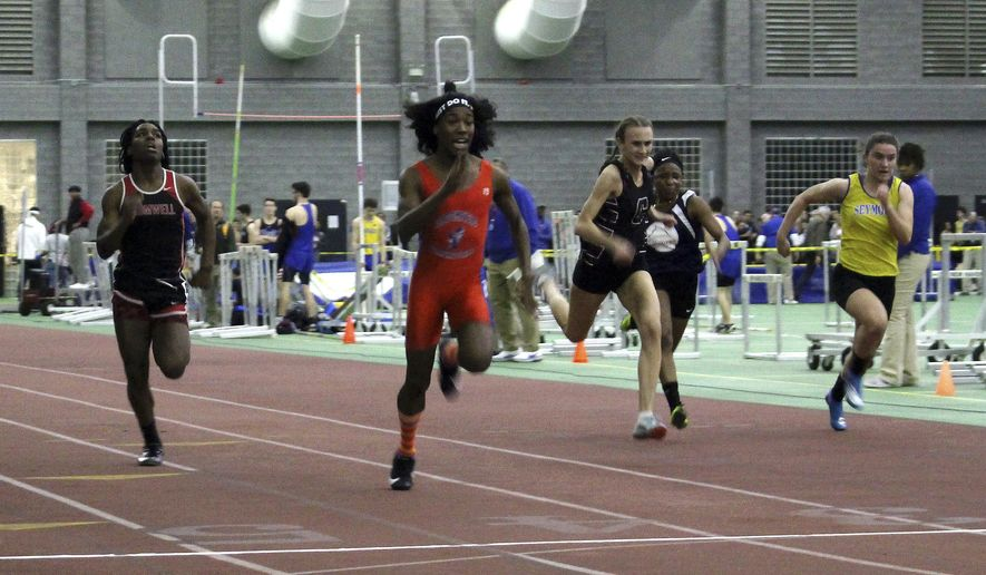 In this Feb. 7, 2019 file photo, Bloomfield High School transgender athlete Terry Miller, second from left, wins the final of the 55-meter dash over transgender athlete Andraya Yearwood, far left, and other runners in the Connecticut girls Class S indoor track meet at Hillhouse High School in New Haven, Conn. The federal Office for Civil Rights has launched an investigation into Connecticut's policy allowing transgender high school athletes to compete as the gender with which they identify. The investigation follows a complaint by the families of three girls, who say they were discriminated against by having to compete in track against two athletes who were identified as male at birth. They say that violates Title IX, the federal law designed to ensure equal athletic opportunities for females. (AP Photo/Pat Eaton-Robb) **FILE**