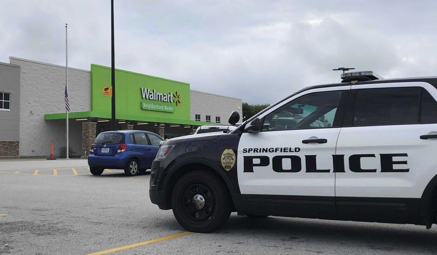Springfield police respond to a Walmart in Springfield, Mo., Thursday afternoon, Aug. 8, 2019, after reports of a man with a weapon in the store. Police in Springfield, Missouri, say they have arrested an armed man who showed up the Walmart store wearing body armor, sending panicked shoppers fleeing the store. (Harrison Keegan/The Springfield News-Leader via AP)