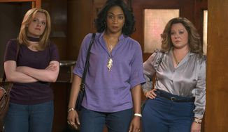 """This image released by Warner Bros. Pictures shows, from left, Elisabeth Moss, Tiffany Haddish and Melissa McCarthy in a scene from """"The Kitchen."""" (Alison Cohen Rosa/Warner Bros. Pictures via AP)"""