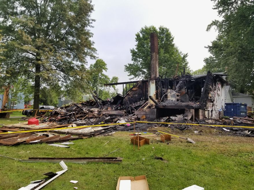 This photo shows the destroyed house of Angela and Brad Frase after an explosion in Sterling, Ohio, Thursday, Aug. 8, 2019. Angela, a black woman who has lived in the small Ohio community with her white husband for more than 20 years, says they've never experienced any prejudice before racial slurs and swastikas were spray painted on their garage and their house was reduced to rubble by an explosion. (Jack Rooney/The Daily Record via AP)