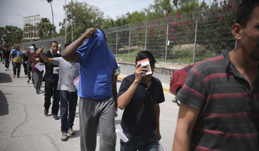 In this July 31, 2019, file photo, migrants return to Mexico, using the Puerta Mexico bridge that crosses the Rio Grande river, in Matamoros, Mexico, on the border with Brownsville, Texas. The long waits are starting to test the patience of immigrants and border towns. (AP Photo/Emilio Espejel, File)