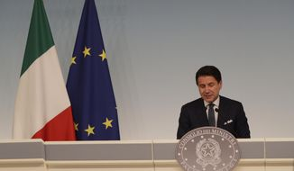 Italian premier Giuseppe Conte gives a press conference at Chigi Palace in Rome Thursday evening, Aug. 8, 2019. Italy faced a government crisis Thursday as Interior Minister Matteo Salvini of the right-wing League party called for a new election, saying his party's coalition with the populist 5-Star Movement had collapsed over policy differences. (AP Photo/Alberto Pellaschiar)
