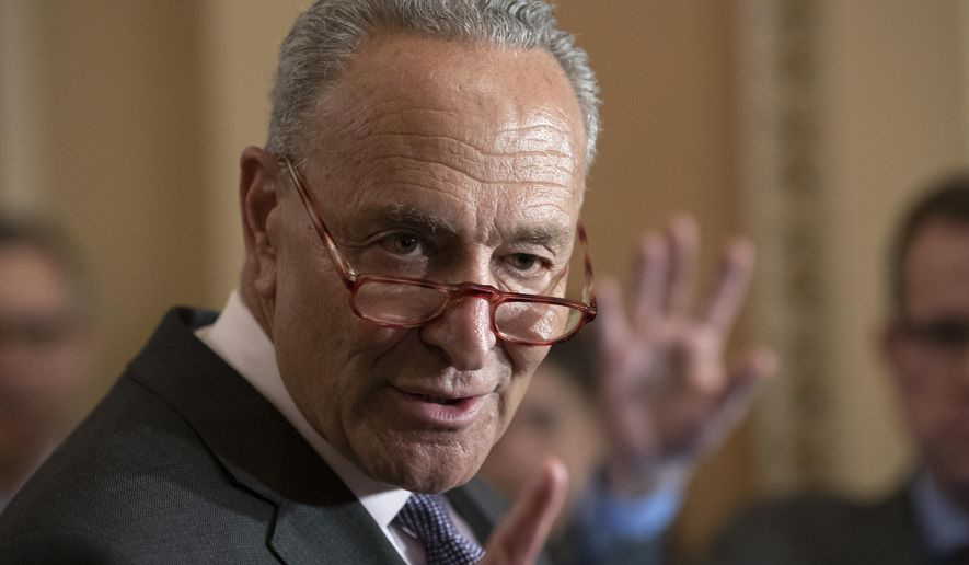 In this July 30, 2019, photo, Senate Minority Leader Chuck Schumer, D-N.Y., takes questions from reporters at the Capitol in Washington. More than 200 mayors, including the mayors of El Paso, Texas and Dayton, Ohio, are urging Senate leaders to call senators back to the Capitol to act on bipartisan gun safety legislation. (AP Photo/J. Scott Applewhite) **FILE**