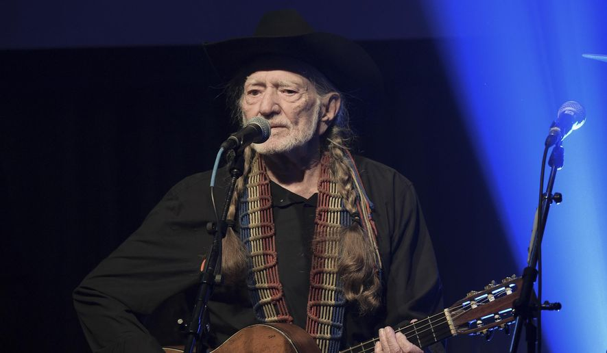 In this Feb. 6, 2019, file photo, Willie Nelson performs at the Producers & Engineers Wing 12th Annual GRAMMY Week Celebration at the Village Studio in Los Angeles. (Photo by Richard Shotwell/Invision/AP, File)