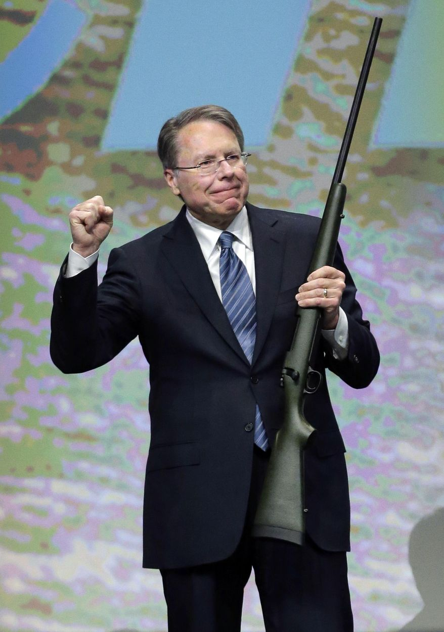 FILE - In this Feb. 23, 2013, file photo, Wayne LaPierre, executive vice president of the National Rifle Association, holds a custom 300 Remington ultra mag during a gun auction after speaking during the Western Hunting & Conservation Expo Banquet at the Salt Palace Convention Center in Salt Lake City. In the latest national furor over mass killings, the tremendous political power of the NRA is likely to stymie any major changes to gun laws. The man behind the organization is LaPierre, the public face of the Second Amendment with his bombastic defense of guns, freedom and country in the aftermath of every mass shooting. (AP Photo/Rick Bowmer, File)