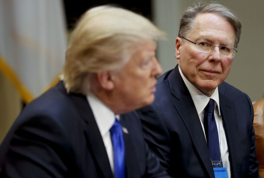 In a Feb. 1, 2017, file photo, National Rifle Associations (NRA) Executive Vice President and Chief Executive Officer Wayne LaPierre listens at right as President Donald Trump speaks in the Roosevelt Room of the White House in Washington. (AP Photo/Pablo Martinez Monsivais, File)