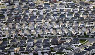 FILE - This April 13, 2019, file photo, shows rows of homes, in suburban Salt Lake City. Heightened investor jitters about slowing global economic growth and the escalating trade war between the U.S. and China have driven bond prices higher, sending the yield on the 10-year Treasury note to the lowest level since October 2016. (AP Photo/Rick Bowmer, File)