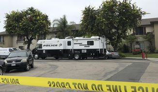 Garden Grove police work at the scene of a stabbing in Garden Grove, Calif., Thursday., Aug. 8, 2019. A man killed four people and wounded two in a string of robberies and stabbings in California's Orange County before he was arrested, police said Wednesday. (AP Photo/Amy Taxin)