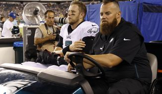 Philadelphia Eagles' Nate Sudfeld is driven off the field after an injury during the first half of the team's preseason NFL football game against the Tennessee Titans, Thursday, Aug. 8, 2019, in Philadelphia. (AP Photo/Michael Perez)