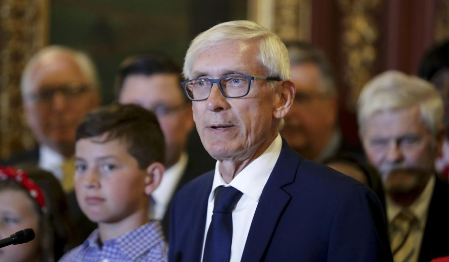 Wisconsin Gov. Tony Evers is shown here taking questions in a July 3, 2019 news conference at the State Capitol in Madison, Wis. Mr. Evers and his fellow Democrats in the state legislature unveiled a proposal on Sept. 19, 2019, to enact a red-flag law to allow authorities to temporarily seize firearms from individuals deemed a threat to others. (Steve Apps/Wisconsin State Journal via AP File) **FILE**