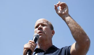 Democratic presidential candidate former Rep. John Delaney of Maryland, speaks at the Des Moines Register Soapbox during a visit to the Iowa State Fair, Friday, Aug. 9, 2019, in Des Moines, Iowa. (AP Photo/Charlie Neibergall)