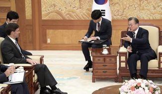 South Korean President Moon Jae-in, right, gestures to U.S. Defense Secretary Mark Esper, left, during a meeting at the presidential Blue House in Seoul, South Korea, Friday, Aug. 9, 2019. Esper arrived in South Korea on Thursday for a two-day visit to discuss regional security and other alliance issues. (Han Sang-kyun/Yonhap via AP)
