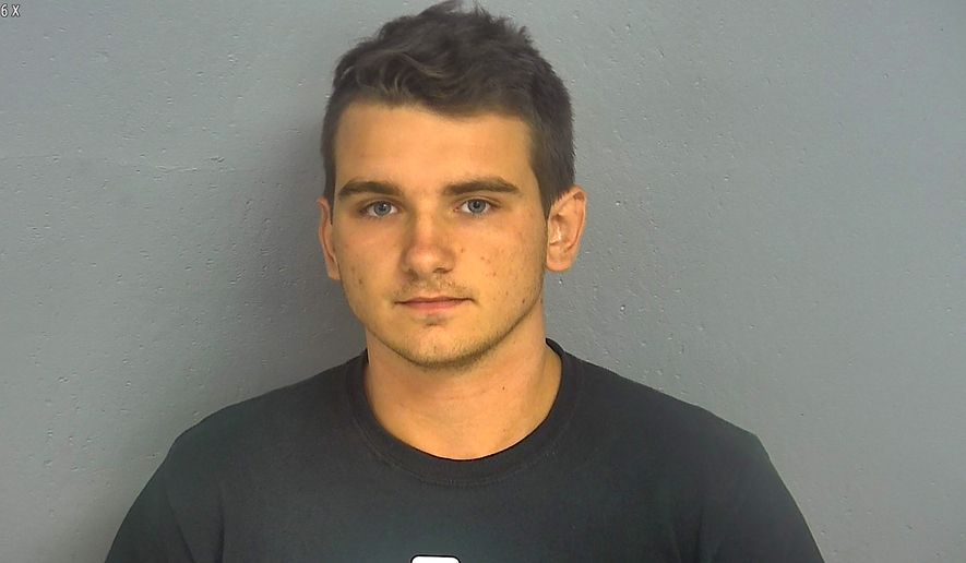 In this undated booking photo provided by the Greene County, Missouri, Sheriff's Office shows 20-year-old Dmitriy Andreychenko. Five days after 22 people were killed at a Walmart store in El Paso, Texas, panicked shoppers fled a Walmart in Springfield, Missouri, after Andreychenko, carrying a rifle and wearing body armor walked around the store before being stopped by an off-duty firefighter. Police on Friday identified the man as Andreychenko, who lived in the Springfield area. (Greene County Sheriff via AP) .