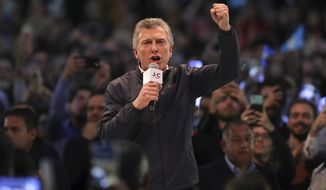 "Argentina's President Mauricio Macri campaigns ahead of this weekend's presidential primary elections in Cordoba, Argentina, Wednesday, Aug. 7, 2019. Macri is running for re-election with the ""Juntos por el Cambio"" party, or Together for Change, in the Sunday primaries ahead of October's presidential election. (AP Photo/Nicolas Aguilera)"