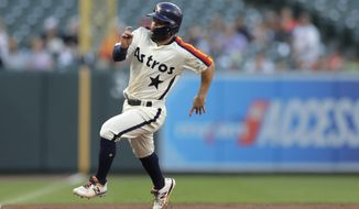 Houston Astros' Jose Altuve runs the bases before scoring on a hit by Alex Bregman during the first inning of a baseball game against the Baltimore Orioles, Friday, Aug. 9, 2019, in Baltimore. (AP Photo/Julio Cortez)