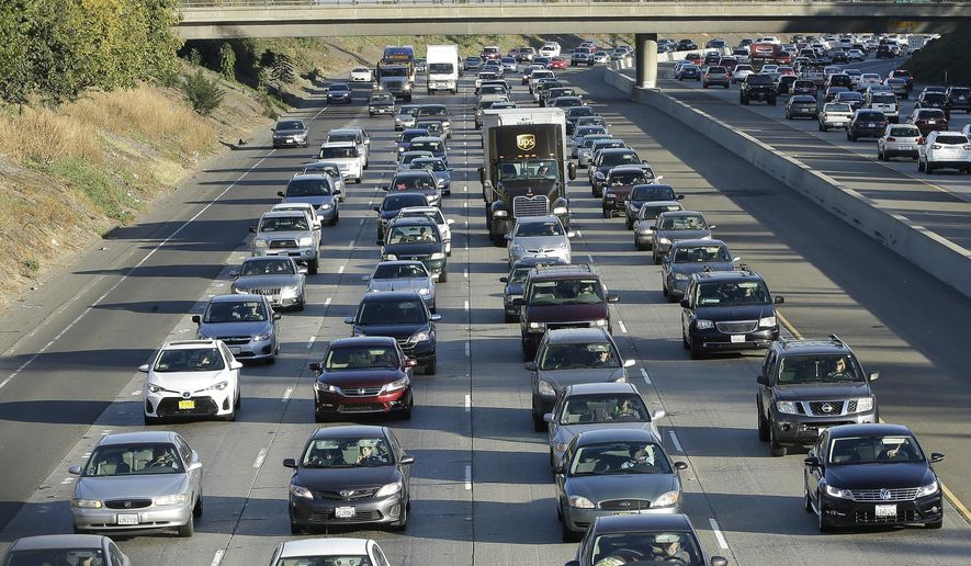 FILE - In this Monday, Oct. 30, 2017, file photo, vehicles crowd Highway 50 in Sacramento, Calif. The California DMV's new voter registration program is confusing to voters and full of technical difficulties according to the findings of an audit released by the state Department of Finance, Friday, Aug. 9, 2019. (AP Photo/Rich Pedroncelli, File)