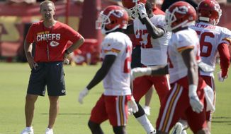 FILE - In this July 29, 2019, file photo, Kansas City Chiefs defensive coordinator Steve Spagnuolo watches a drill during NFL football training camp, in St. Joseph, Mo. There's a good chance Juan Thornhill will start at safety for the Chiefs in Week 1. That bucks a trend not only for coach Andy Reid but also defensive coordinator Steve Spagnuolo when it comes to rookies.(AP Photo/Charlie Riedel, File)