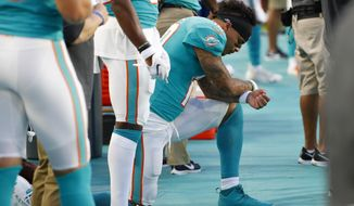 Miami Dolphins wide receiver Kenny Stills kneels during the national anthem before the team's preseason NFL football game against the Atlanta Falcons, Thursday, Aug. 8, 2019, in Miami Gardens, Fla. (AP Photo/Wilfredo Lee)