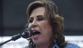Former first lady Sandra Torres, who's running for president with the National Unity of Hope party, UNE, speaks to supporters during her closing campaign rally in Mixco, Guatemala, Friday, August 9, 2019. Guatemala is going to the polls for second-round runoff elections Sunday for the presidency. (AP Photo/Oliver de Ros)