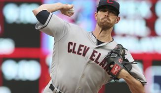 Cleveland Indians pitcher Shane Bieber throws to a Minnesota Twins batter during the first inning of a baseball game Friday, Aug. 9, 2019, in Minneapolis. (AP Photo/Jim Mone)