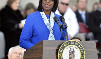 FILE - In this Dec. 8, 2015, file photo, Kentucky Lt. Gov. Jenean Hampton speaks to the spectators on the steps of the Kentucky Capitol following her public swearing-in ceremony in Frankfort, Ky. Hampton says she never talked with Gov. Matt Bevin about his administration's dismissal of two of her top staffers without her consent. (AP Photo/Timothy D. Easley, File)
