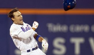 New York Mets' Michael Conforto reacts after hitting a walkoff single during the ninth inning to win the baseball game against the Washington Nationals, Friday, Aug. 9, 2019, in New York. (AP Photo/Mary Altaffer),