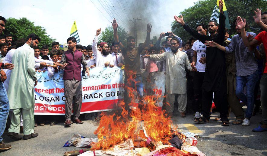 Pakistani Kashmiris burn effigies of Indian leaders at a protest in Muzaffarabad, Pakistan, capital of Pakistani Kashmir, Friday, Aug. 9, 2019. (AP Photo/M.D. Mughal) ** FILE **